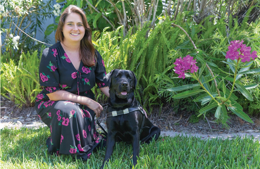 Rachel Weeks with her guide dog Plum at Southeastern Guide Dogs in Palmetto, Florida.
