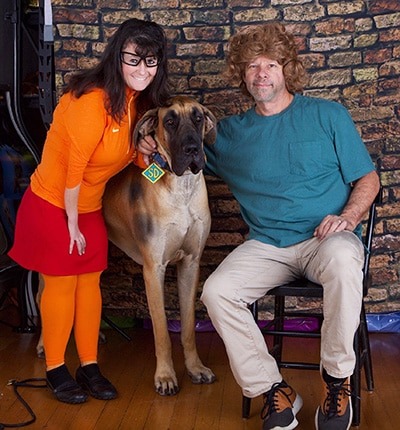 Angie and Joe Scavone dress up as Scooby Doo's Velma and Shaggy for Halloween, with Voodoo in the title role.