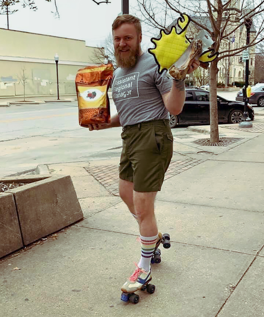 Tony Gradert donning roller skates to deliver curbside is just one of the ways the Lucky Dog team has fun at work.